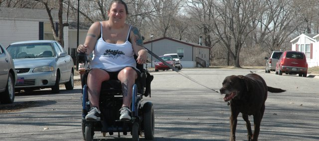 Cherie Armstrong walks her recently deceased dog Mocha around her Edwardsville neighborhood. Armstrong and Mocha were best friends and were a recognizable duo in the community.