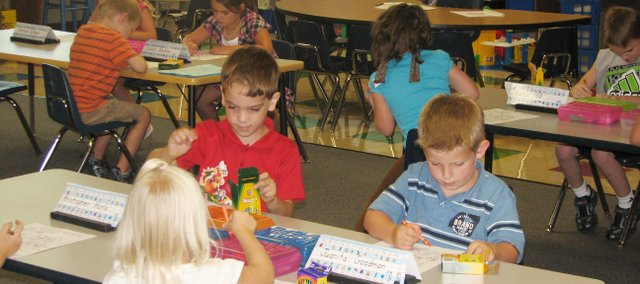 Students in Amy Salazars Basehor Elementary School kindergarten class work on a project Aug. 13 during their first day of school.