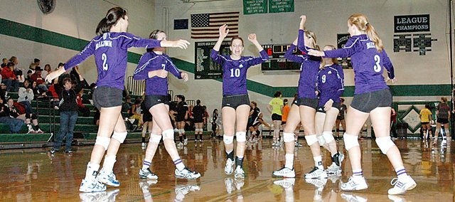 Baldwin High School volleyball players celebrate winning a point Saturday. Baldwin beat Basehor-Linwood as it went 1-3 at the De Soto Spikefest.