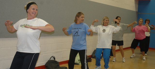 Zumba participants work on their dance moves during the Latin dance-inspired exercise routine, now being offered at the Bonner Springs Community Center.