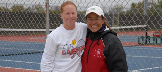 Lansing High senior Amy Briggs and LHS tennis coach Rachel Elkins were all smiles after Briggs won the Class 5A regional championship on Saturday at Topeka Seaman.