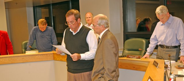 De Soto Mayor Dave Anderson reads Thursday from a proclamation naming Oct. 25 The Rev. Richard Copeland Day in honor of his 50 years in the ministry as the De Soto Baptist Church pastor listens. About 20 of his congregation were in attendance for the surprise announcement.