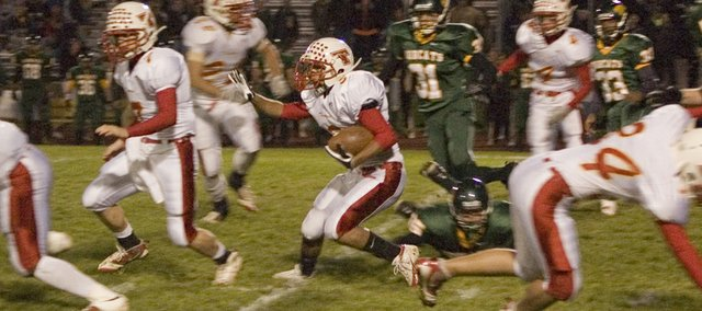 Shawn Marin returns a kickoff for Tonganoxie High at Basehor-Linwood on Friday night. Marin intercepted a pass late in the fourth quarter, which helped send the district game to overtime, where the Chieftains eventually lost, 28-27.