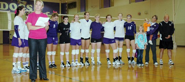"Baldwin High School volleyball coach Kelly Brown, front, spoke a few words about former BHS player Alex Bergan to the crowd Thursday night. BHS held a ""Celebrate Alex Night"" to remember Bergan, who died less than a year ago. Bergan's parents, Marc and Kim, are pictured at the right of the photo."