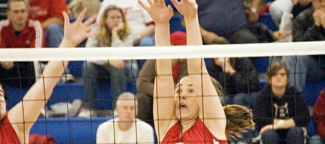 Danielle Miller rises up for a block during Tonganoxie High's semifinal match with Mill Valley at the Kaw Valley League tournament in Perry. Although the Chieftains lost that match, it was their only setback on the day as THS went 5-1 to finish third.