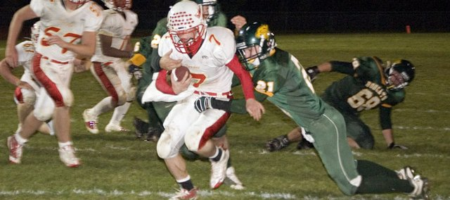 Jeremy Carlisle runs up the middle for Tonganoxie High in overtime at Basehor-Linwood on Friday. Although the carry put THS on the one-yard line, the Chieftains were unable to score and eventually lost in double overtime, 28-27.
