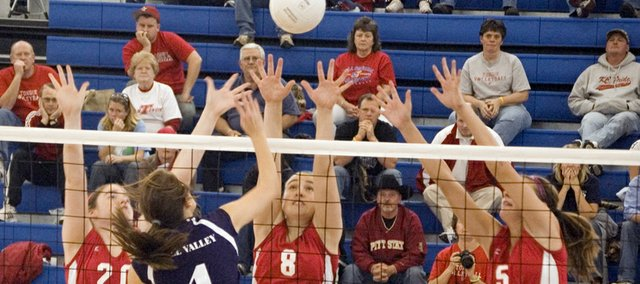 Maggie Franiuk, Danielle Miller and Molly O'Hagan extend to try and block a Mill Valley tip during a Kaw Valley League semifinal on Saturday at Perry. Although Tonganoxie High lost that match, it was the team's only setback of this past week, and the Chieftains finished third at the KVL tournament.