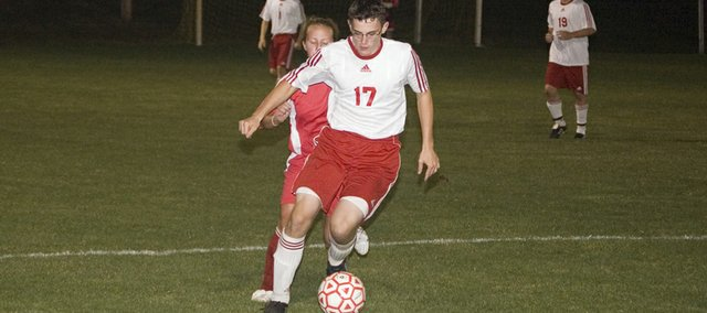 Matt Titterington pushes the ball up the sideline for Tonganoxie High on Monday night during the Chieftains' 1-0 win over Atchison.