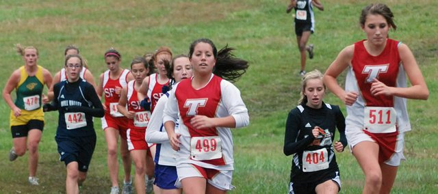 Tonganoxie High runners Shelby Maxon and Nikki Beggs stayed close to one another throughout the KVL race on Thursday as Beggs finished 31st and Maxon was less than two seconds behind her at 32nd.