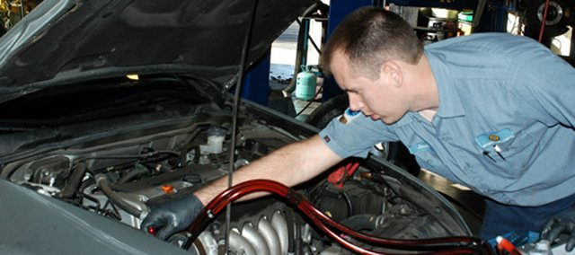 Jason Kreuger works on the power steering of a vehicle at Weaver's Auto Center, 6502 Vista Drive, Shawnee.