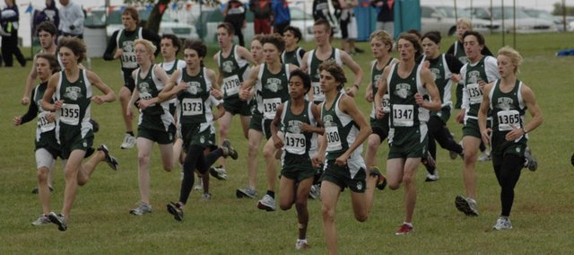 The De Soto boys cross country team begins the Frontier League cross country meet Thursday at Rim Rock Farm. The boys team won the league championship and the girls finished second overall.