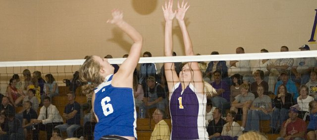 Kylie Shufflebarger goes up for a block in this Mirror file photo. The McLough High volleyball team will face Jefferson County North in a the first round of a Class 3A sub-state tournament at Wellsville on Saturday.