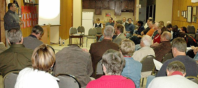 Monday's public forum on sales tax questions brought a crowd of about 35 to Legion Hall. City Administrator Jeff Dingman, left, gave a presentation prior to the forum.