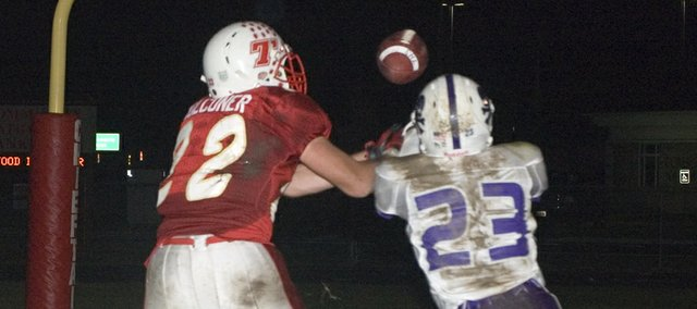 A pass intended for Tonganoxie High senior tight end Dylan Faulconer is broken up by Piper's Dorian Hooks on Friday night at Beatty Field. Faulconer would later haul in two touchdown catches in the game but the Chieftains lost to the Pirates, 25-22, ending their postseason hopes.