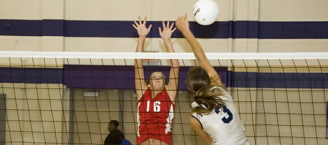 Tonganoxie High senior Abby Eisman tries to block a St. James Academy attack in a sub-state semifinal on Saturday evening at Kansas City, Kan. The Chieftains lost the match, ending their season.
