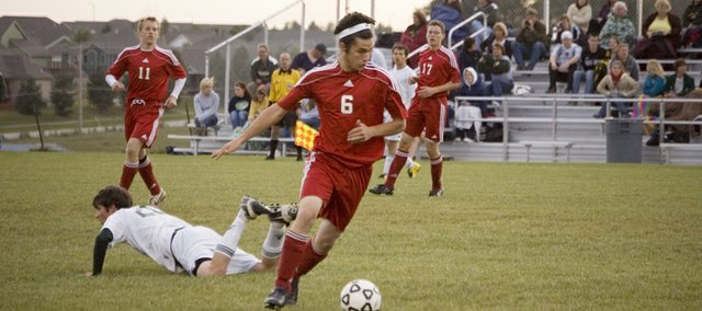 Tonganoxie High senior Preston Putthoff pushes up on an attack in this Mirror file photo. The Chieftains received the No. 8 seed in the Class 4-3-2-1A northeast regional bracket and will travel to Atchison, a team THS beat twice this past week, on Tuesday to open the playoffs.