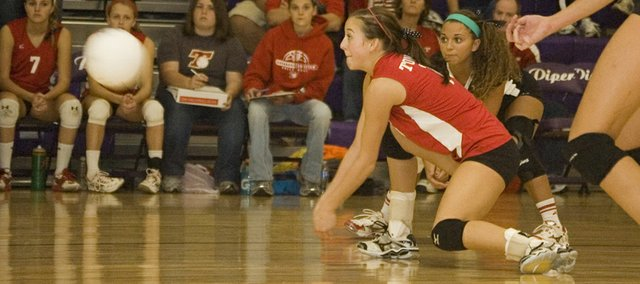 Abby Eisman gets low for a dig against St. James Academy on Saturday at a sub-state tournament in Kansas City, Kan. Despite Tonganoxie High's best efforts, the volleyball team's season ended in a sub-state semifinal loss to SJA, the defending Class 4A state champion.