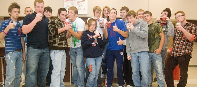 Students in the THS entrepreneurship class manning the Smoothie Shack on Tuesday are, from left, Isaac Jones, teacher Jared Jackson, Dylan Young, Trevor Edmonds, Tyler Lupton, Ben Myers, Erica Hanson, Chad Roberts, Molly O'Hagan, DJ Lindsay, Ethan Lorance, Justin Soetaert, Dylan Fosdick, Vinnie Angell, Jared Knipp and Caleb Wager. They and several other students in the class operate the store at the Chieftain Room in Tonganoxie High School. Not pictured were: Dylan Caywood, Mitch DeHoff, Cooper Gish, Clint Hallgrimson, Austen Holloway, Deven Howe, Dylan Howe, Jeremie Maus, Dylan Pendleton, Colin Rosewicz, Jeff Sims, Jeremy Wagner, Brandon Yoder, Megan Brungardt, Samona Guerrero, Carson McCormick, Jordan Schiltz and Kelsey Stockman.