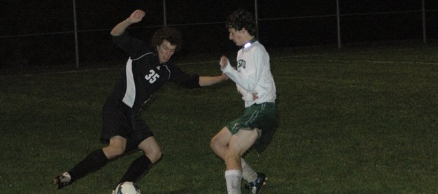 De Soto senior Tyler Berg, right, battles for the ball against a Paola player Thursday at De Soto. The Wildcats beat the Panthers 4-0 on Senior Night and beat Immaculata 5-0 in regional play Tuesday at De Soto.