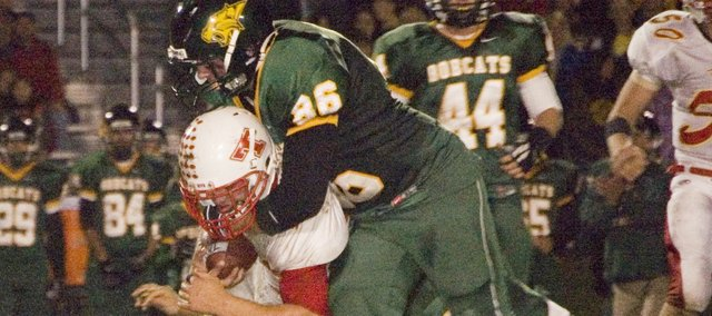 Richie ODonnell, Basehor-Linwood senior, makes a tackle during a district playoff victory against Tonganoxie. ODonnell forced a fumble during Basehors 34-21 victory over Bishop Ward.
