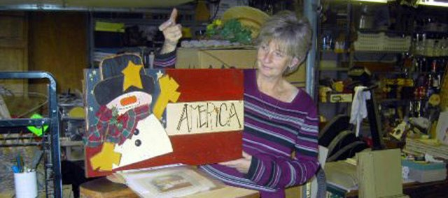Basehor resident Nancy Hicklin prepares homemade crafts to take to the 2005 Alpha Delta Kappa craft show. Janice Walker, Beta Epsilon Chapter president, said the organization worked hard to make sure all items at the show were handcrafted.  This years Alpha Delta Kappa craft show will be 8 a.m. to 4 p.m. Nov. 7, the same day as the Holy Angels Catholic Church craft show.