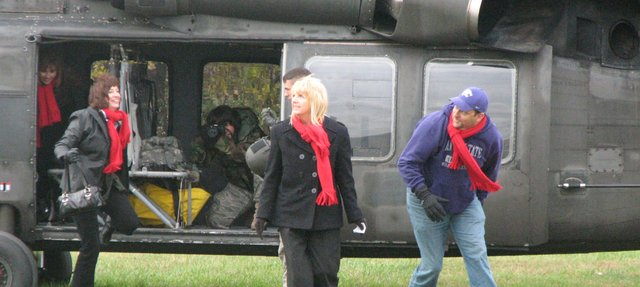 Linwood Elementary Principal Cindy Hiebert (right), Glenwood Ridge Elementary Principal Jan Hancock (middle) and Basehor-Linwood Middle School Principal Mike Wiley get off a military helicopter that landed Friday morning at Basehor-Linwood High School.