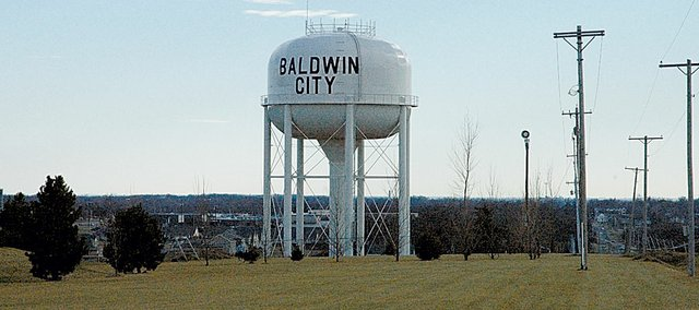 The water tower north of Baldwin City could be getting filled with water that&#39;s not from Lawrence&#39;s treatment plant if plans for purchasing it from a Johnson County Rural Water District come through. Baldwin City Mayor Ken Wagner is pursuing different options because of the high price of Lawrence water.