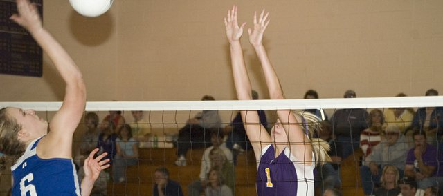 McLouth High volleyball senior Kylie Shufflebarger goes up for a block in this Mirror file photo. Shufflebarger was one of five Bulldogs seniors who played their last matches for MHS in a sub-state loss.