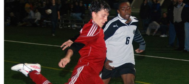 Tyler Bartholomew gears up to to clear the ball for Tonganoxie High on Thursday against Maranatha Academy at the Overland Park Soccer Complex. The Chieftains lost to the Eagles, 3-0, in the Class 4-3-2-1A northeast regional No. 2 final.