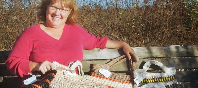 Rural Tonganoxie resident Karen Parrett has made roughly 30 plastic bag totes. It's her way of recycling used plastic bags. On average, she cuts 50 plastic bags into strips and crochets those strips together for the totes, which she's made for friends and family and are being sold in a downtown Leavenworth store.