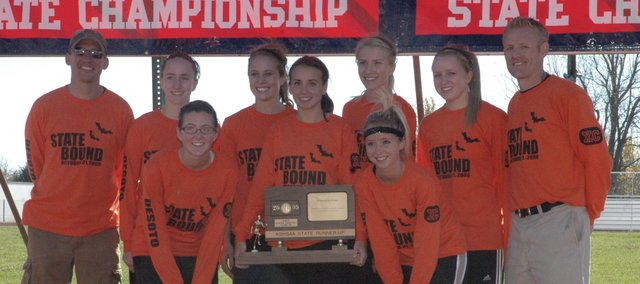 The De Soto girls cross country team celebrates its second-place finish at the state cross country meet Saturday in Wamego. Pictured back row (from left to right) are head coach Chris McAfee, Sarah Churchwell, Beth Reichenberger, Lacey Erickson, Hannah Jokisch and assistant coach Chad Brecheisen. Pictured in front (from left to right) are Jordan Kline, Carly Stanley and Ellie Sheridan.
