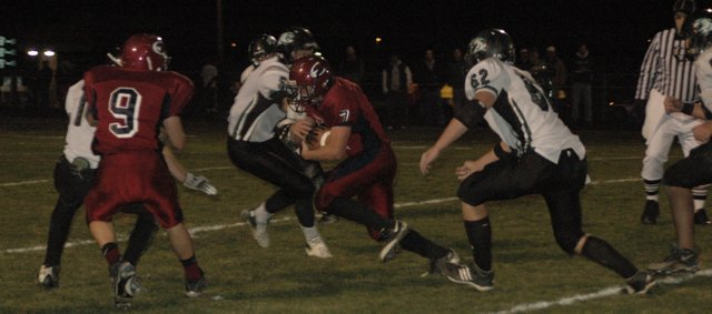 Eudora senior Evan Cleveland runs for a big gain in the third quarter as Reece Long (9) blocks against De Soto Tuesday at Eudora. Cleveland ran for 150 yards and scored three rushing touchdowns and threw for another in Eudora's 28-0 victory.