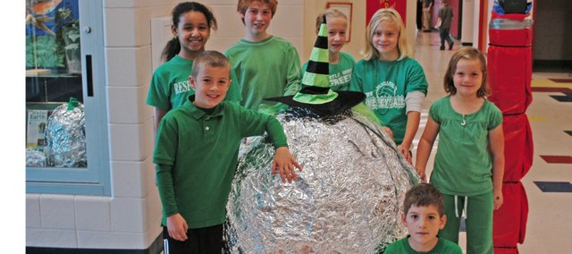Starside Elementary School students, Dylan Nimrod, Chelyi Roddick, Colton Pasquale, Katey Hinds, Becca Clancy, Jillian Schnieders and Sergio Marquez celebrated Red Ribbon Week by posing with Bob the Ball. Students wore green on Wednesday to promote drug awareness.