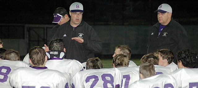 Baldwin High School coach Mike Berg, standing center, talks to his team following Tuesday's loss at Bishop Miege. BHS finished the season 2-8, but made the state playoffs.