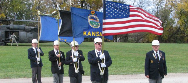 Members of the Basehor Veterans of Foreign Wars Post 11499 march near the football field at Basehor-Linwood High School after leading students in the Pledge of Allegiance. Friday's events wrapped up the district's Red Ribbon Week.
