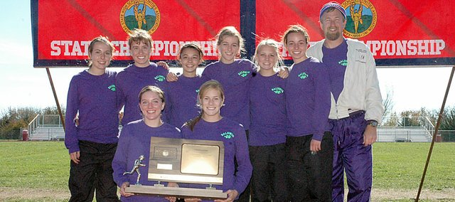 The Baldwin High School girls won their third straight Class 4A cross country title Saturday in Wamego. In the front holding the trophy are seniors Julie Hill, left, and Connor Twombly. Behind them from left are Abi Hartzell, Heather Karlin, Sienna Durr, Carol Whaley, Elizabeth Sigvaldson, Kaitlyn Barnes and coach Mike Spielman.