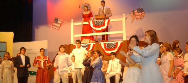 Donny Parr, center, as Harold in The Music Man, smiles as towns people play the instruments he has sold them. The show runs at 7 p.m. Thursday, Friday and Saturday.