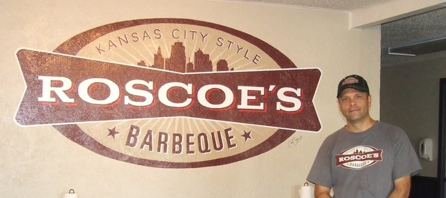 Roscoe Davis stands in his new Edwardsville barbecue establishment, Roscoe's BBQ, 9711 Kaw Drive. Roscoe's opened Oct. 23.