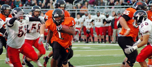 Baker University senior Richie Bryant (No. 1) runs through a hole past several Benedictine defenders during the Wildcats' home game Oct. 17. Bryant rushed for 114 yards on Saturday as Baker defeated Evangel 24-17. He will be one of 21 seniors honored before the Wildcats' final regular season game, which starts at 1 p.m. Saturday at Liston Stadium.