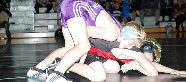 Baldwin Junior High School eighth grader Tucker Clark, top, controls his match Tuesday at the Bulldogs' home meet. Clark won the match 11-0  over the Anderson County wrestler.