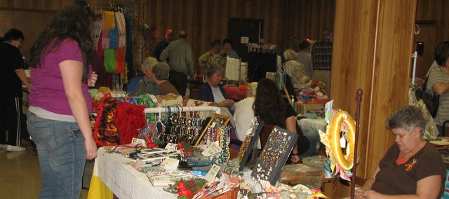 Vendors at the Holy Angels Catholic Church display their creations Saturday for customers at the annual craft fair. The church's fair took place the same day as the Alpha Delta Kappa craft show at Basehor-Linwood High School. Both shows featured homemade items from crafters such as jewelry, stationary and holiday decorations and brought in money to be distributed back to the community through scholarships and charitable organizations.