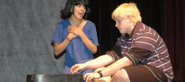 """Lucy, played by Bonner Springs High School senior Emily Warren, (top) and Schroeder, played by junior T.J. Walker, rehearse a scene for the school's fall musical, """"You're a Good Man, Charlie Brown,"""" which opens at 7 tonight."""