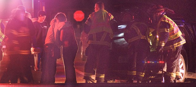 Darla K. Heard, 46, Oskaloosa, left, embraces someone soon after she was involved in a two-vehicle accident around 5:30 p.m. Wednesday at U.S. Highway 24-40 and Stone Creek Drive in Tonganoxie.