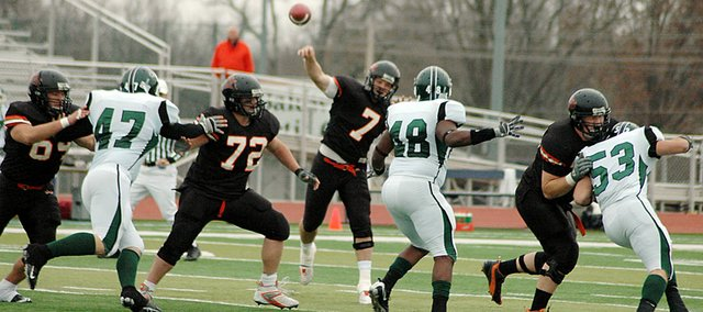 Baker University senior Mack Brown (No. 7) throws a pass during the first quarter Saturday. Brown completed 25 of 38 passes for 207 yards and three touchdowns in the 33-7 victory over Central Methodist.