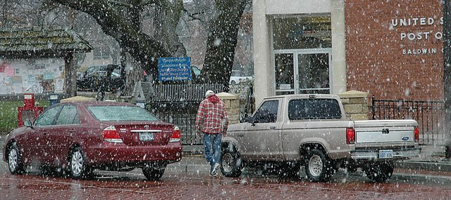 Snow flakes were plentiful Monday in downtown Baldwin City, but eventually turned back to rain. Overnight the snow returned and covered the ground and vehicles, but roads were fine. The two days of precipitation brought 1.1 inches in Vinland.