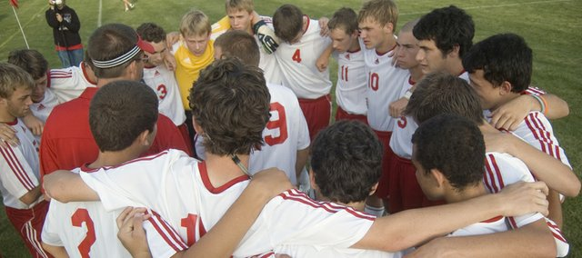 The Tonganoxie High boys soccer team huddles before a match this season. By winning seven times in 2009, the Chieftains matched their win total from the previous three years.