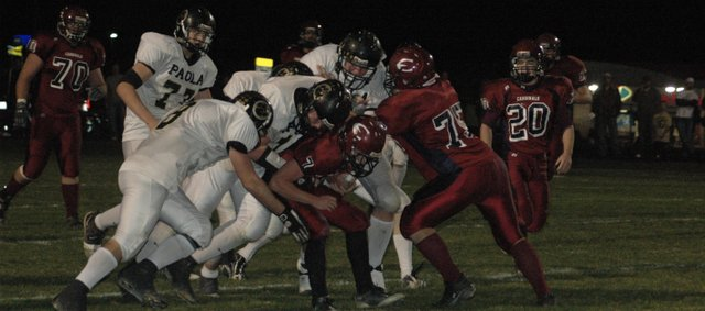 Eudora quarterback Evan Cleveland (7) is stopped by a host of Paola players as Matt Schultz (75) blocks during Friday's sectional contest at Eudora. The Cardinals' season came to an end with a 33-14 loss.