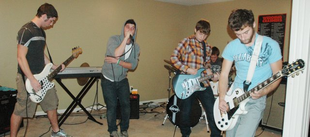 Members from Seven Minute Goodbye rehearse songs they will perform in the final round of an upcoming battle of the bands at the Beaumont Club in Kansas City. Pictured are, from left, Brendan Martin, Seth Clements, Liam Martin, drummer Kabes Bailey and Ryan Holcomb.