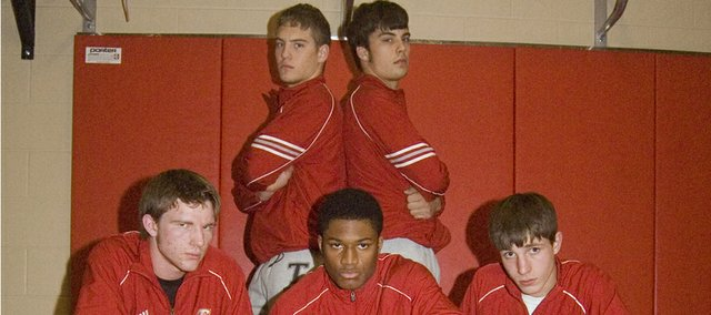 The Tonganoxie High wrestling team's five seniors — (front row) Michael Sullivan, Austen Holloway, Justin Crotty, (back row) Jeremie Maus and Zack Kaighin — lead a Chieftains squad that is expecting results this season.