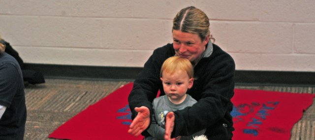 Denise Pener and her 17-month old daughter, Charlotte, participate during a Baby Sing and Sign class at Shawnee Mission Medical Center. The class helps parents and their babies communicate using simple signs, such as, thank you, please, mommy and daddy.